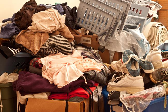 4- Pile of misc items stored in an unorganized fashion in a room